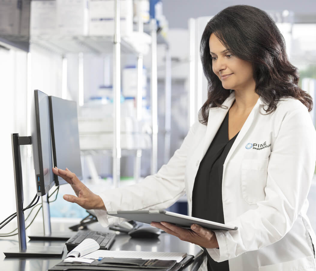 pharmacist reviewing data